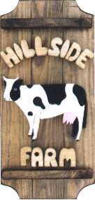 Cow on a 3 board sign.