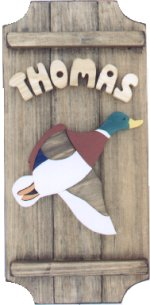 Duck on a 3 board sign.