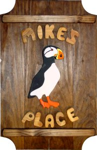 Puffin on a 4 board sign.