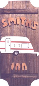 Travel Trailer on a 3 board sign.