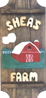 Red Barn on a 3 board sign.