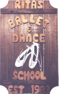 Ballet Slippers on a 3 board sign.