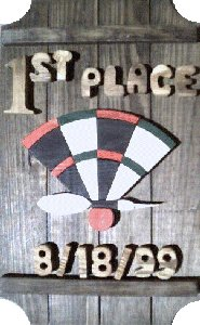 Dart Board on a 4 board sign.