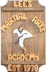 Karate on a 4 board sign.